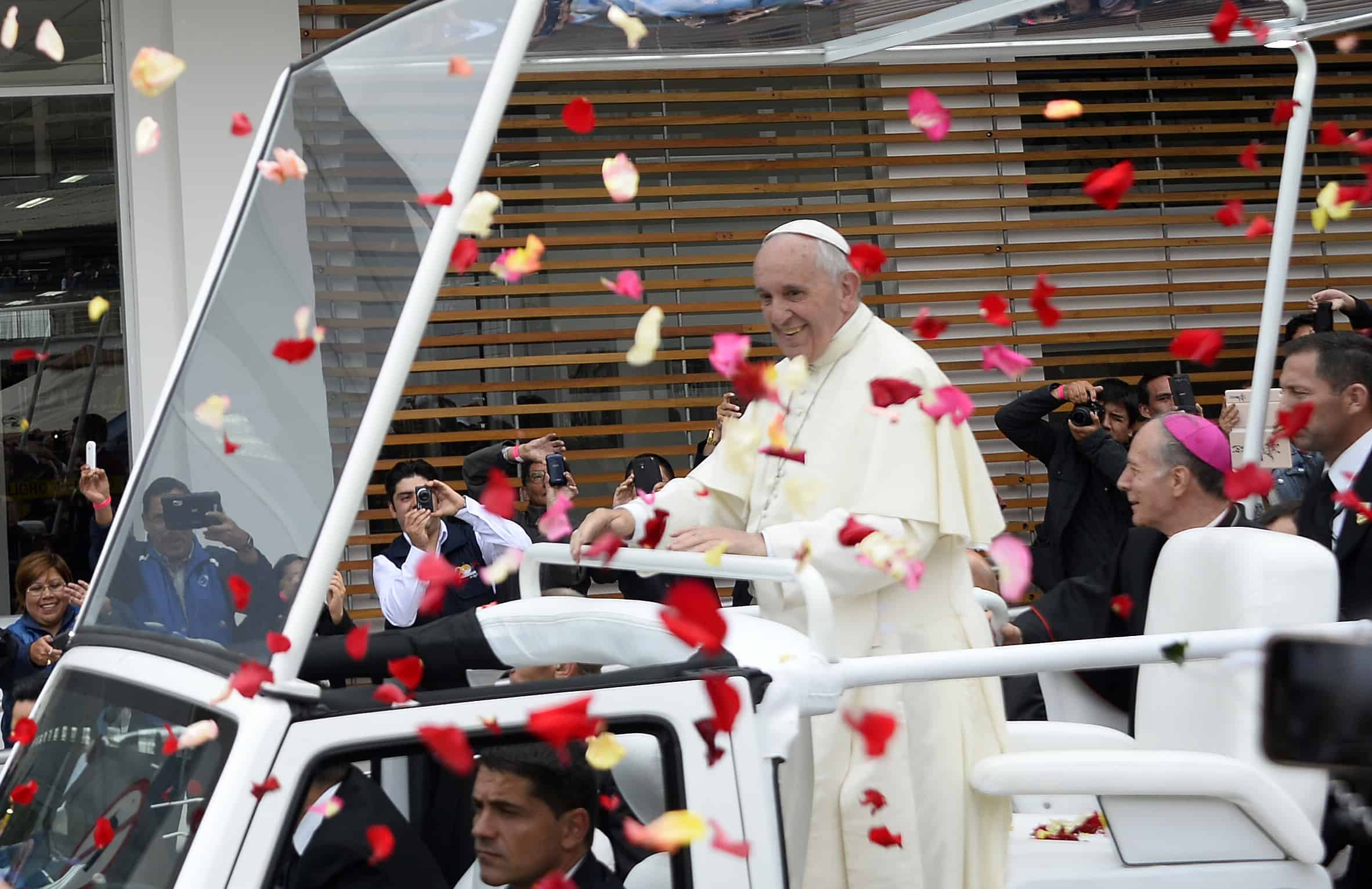 Pope Francis is greeted by a crowd as he rides through the Ecuadorean capital, Quito, on July 7, 2015.