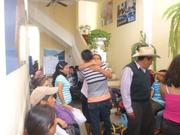 Families reunite at Casa Nuestros Raíces in Quetzaltenango, Guatemala. The shelter provides temporary housing to child migrants after they've been deported, July 14, 2015.