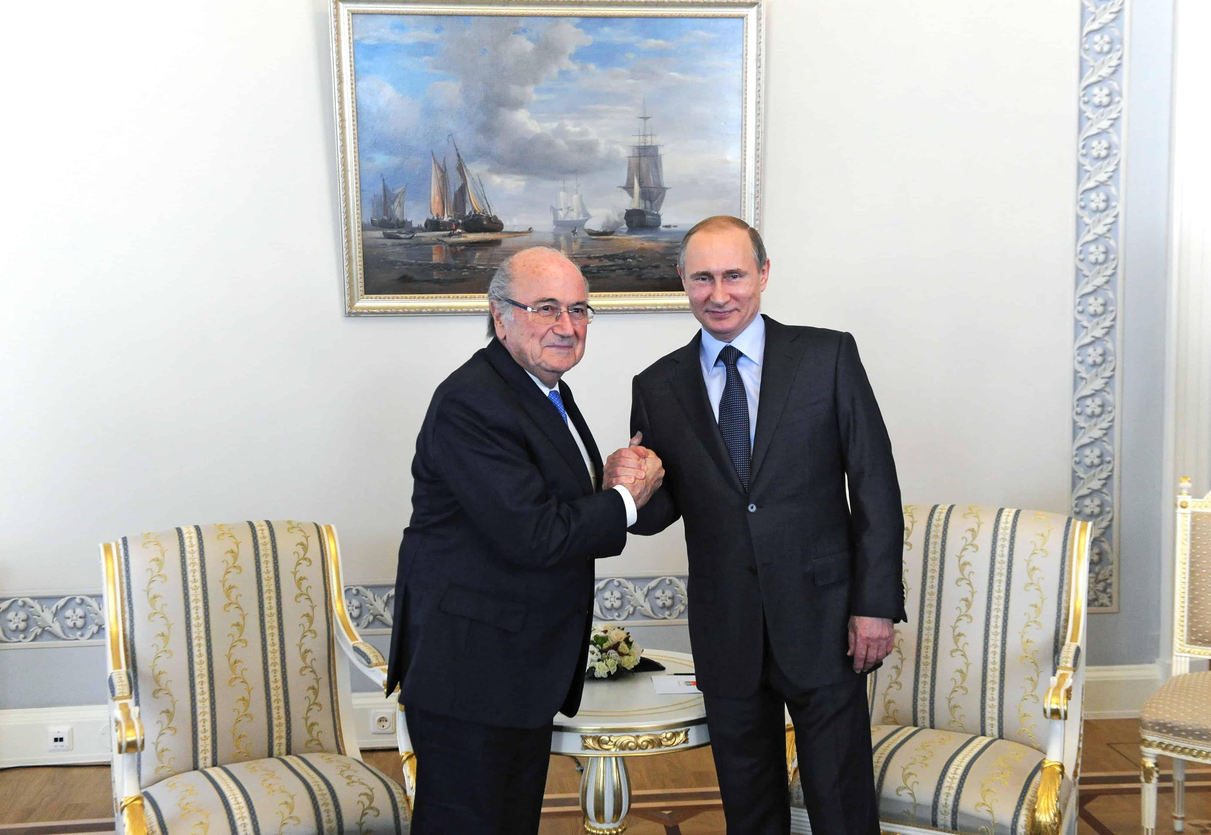 Russian President Vladimir Putin (R) poses with FIFA President Joseph Blatter.