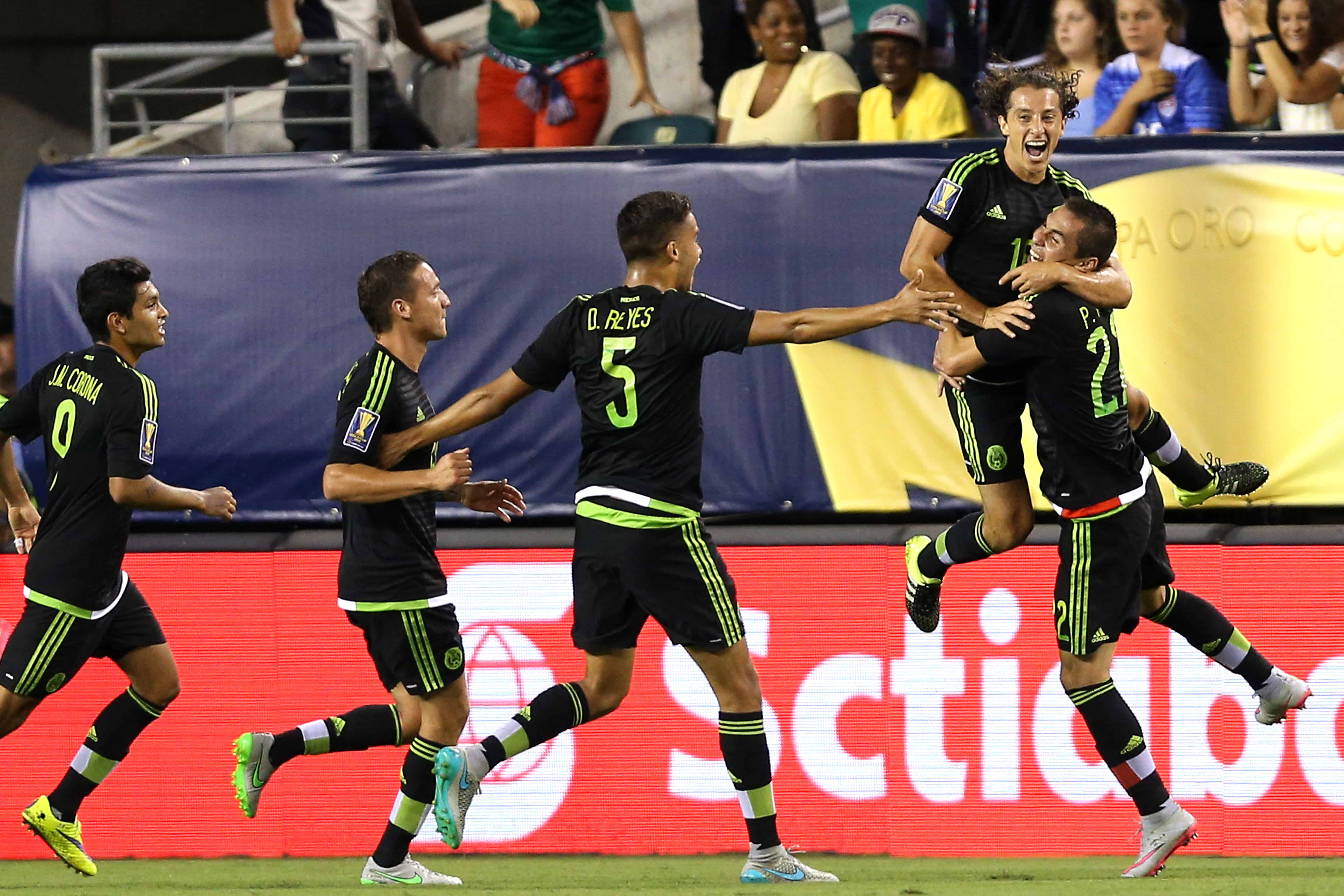 Andrés Guardado (#18) of Mexico celebrates.