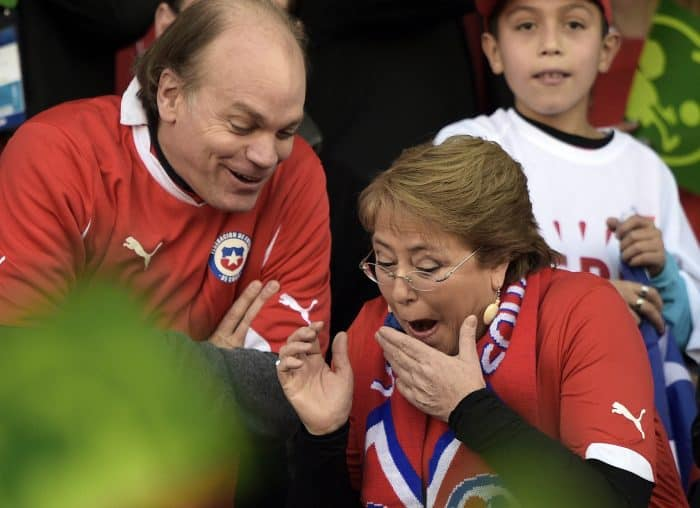 Chilean President Michelle Bachelet, right, attends the 2015 Copa América football championship final .