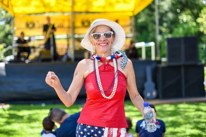 Eugenia Flores dances to the music during the 4th of July picnic at the Cervecería Costa Rica grounds.