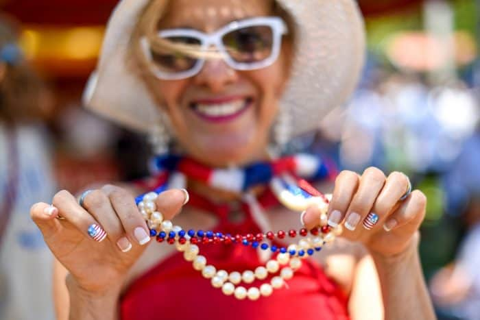 Eugenia Flores shows off her patriotic beads and fingernails.