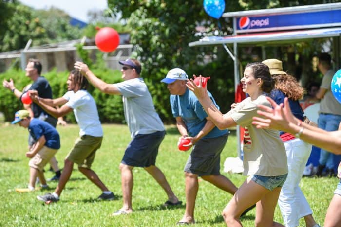 The water balloon toss had participants deep in concentration.