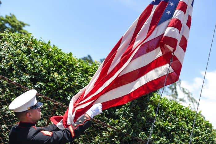 The flag-raising ceremony is one of the most important parts of the 4th of July picnic.
