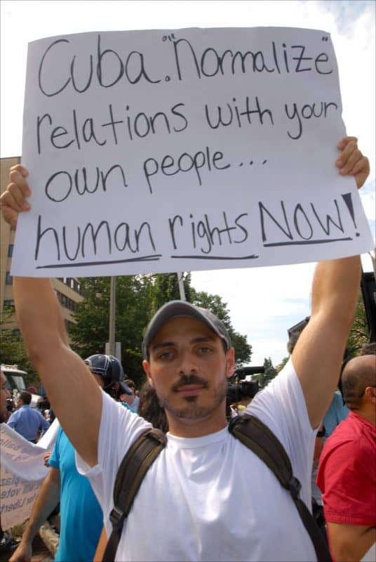 Protester in front of Cuban Embassy in Washington urges Cuba to come clean on human rights and release all political prisoners, July 20, 2015.
