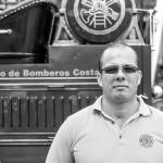 Greivin Leon from the Bario Mexico Fire Station poses in front of the 1910 Knox, the first fire truck to arrive in Costa Rica in 1913.