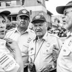 A group of veteran firefighters share a moment during the celebration of the 150 anniversary of the Costa Rican Fire Department, July 26.