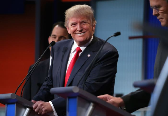Donald Trump participated in the August 6 Republican presidential candidate debate a day after he reportedly made a $100 million offer to buy a Colombia's Atlético Nacional.