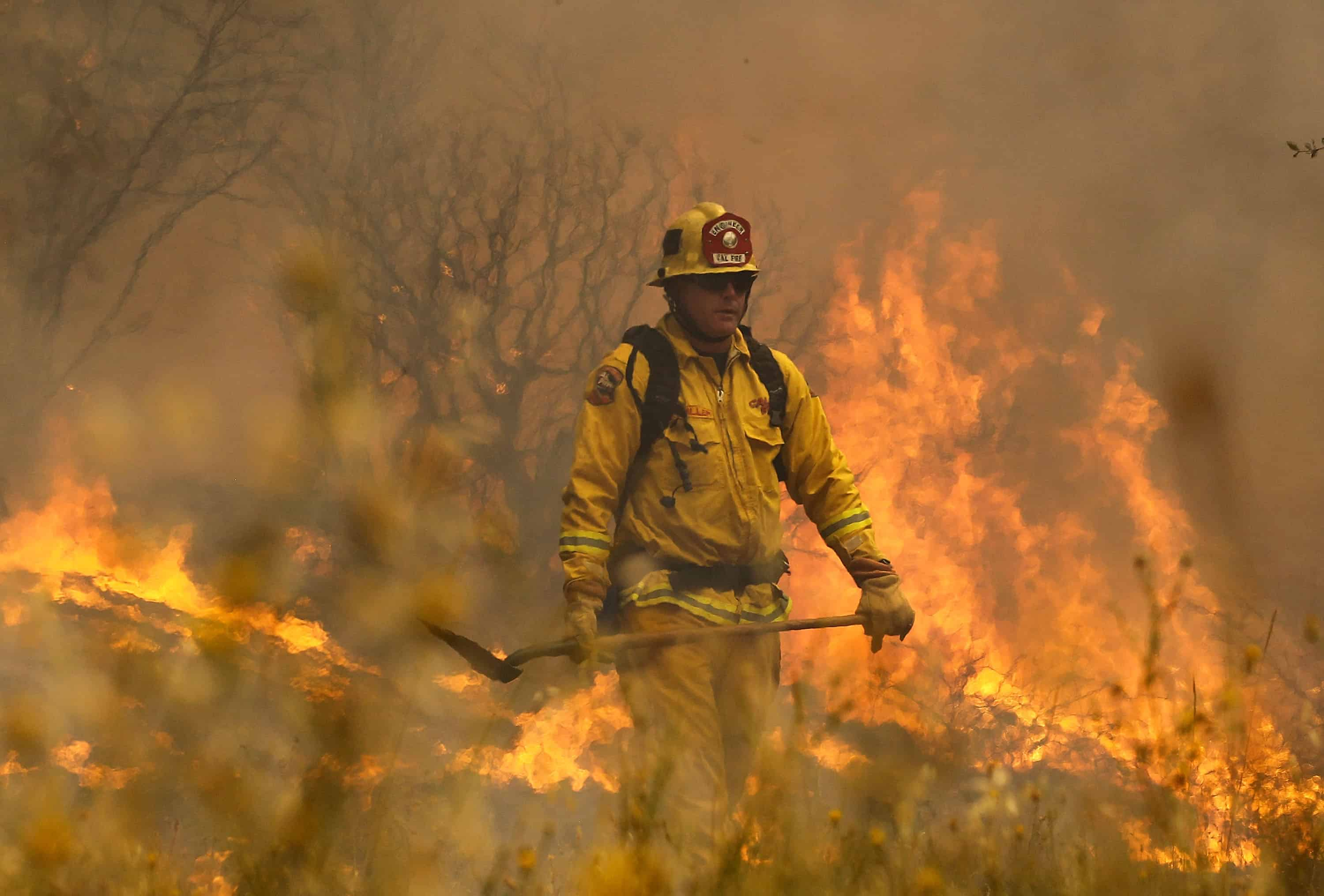 Cal Fire firefighter Johnny Miller monitors flames from the Rocky Fire.