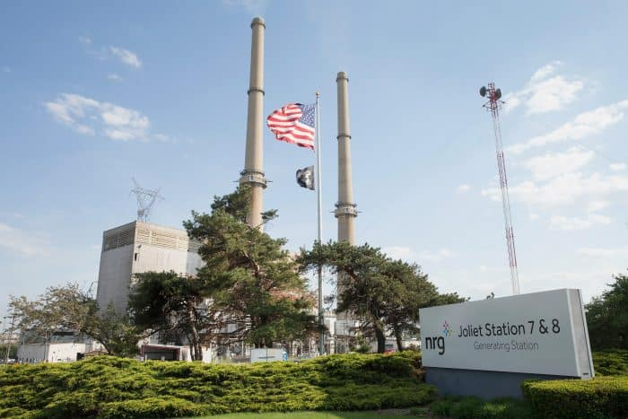 A U.S. flag hangs in front of NRG Energy's Joliet Station power plant.