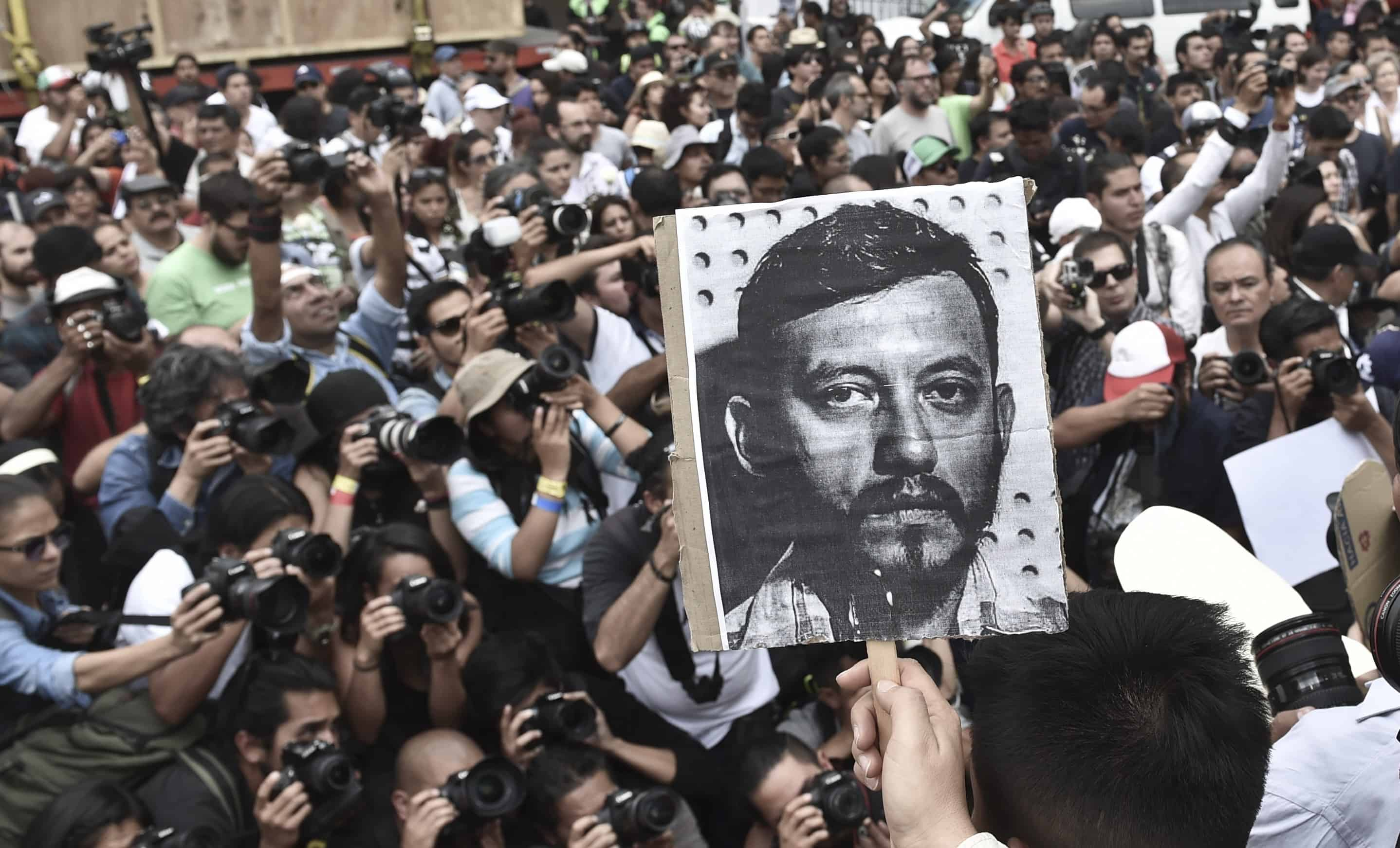 Mexican photojournalists hold pictures of their murdered colleague Rubén Espinosa during a demonstration at the Angel of Independence square in Mexico City, on Aug. 2, 2015.