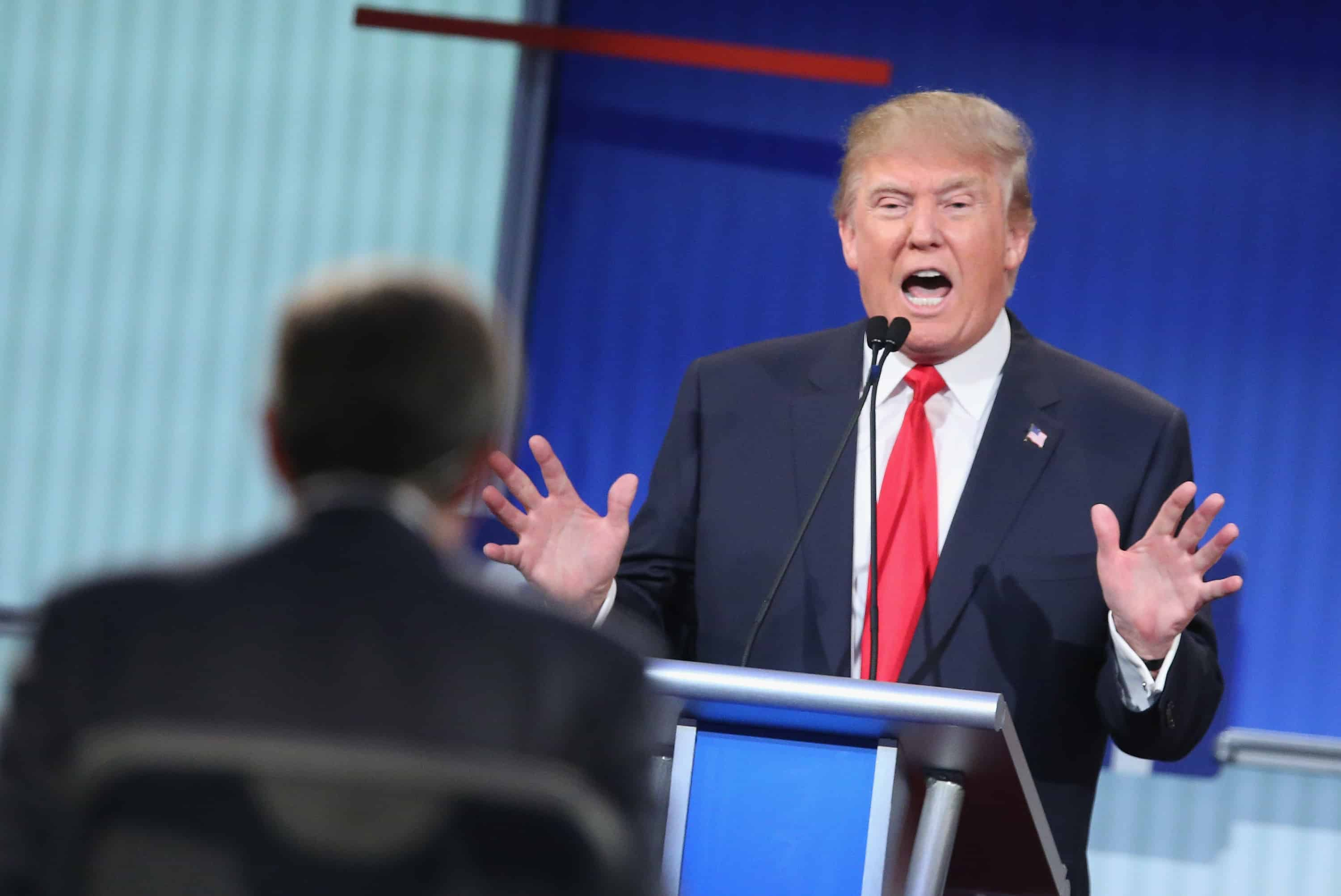 Republican presidential candidate Donald Trump fields a question during the first Republican presidential debate hosted by Fox News and Facebook at the Quicken Loans Arena on August 6, 2015 in Cleveland, Ohio.