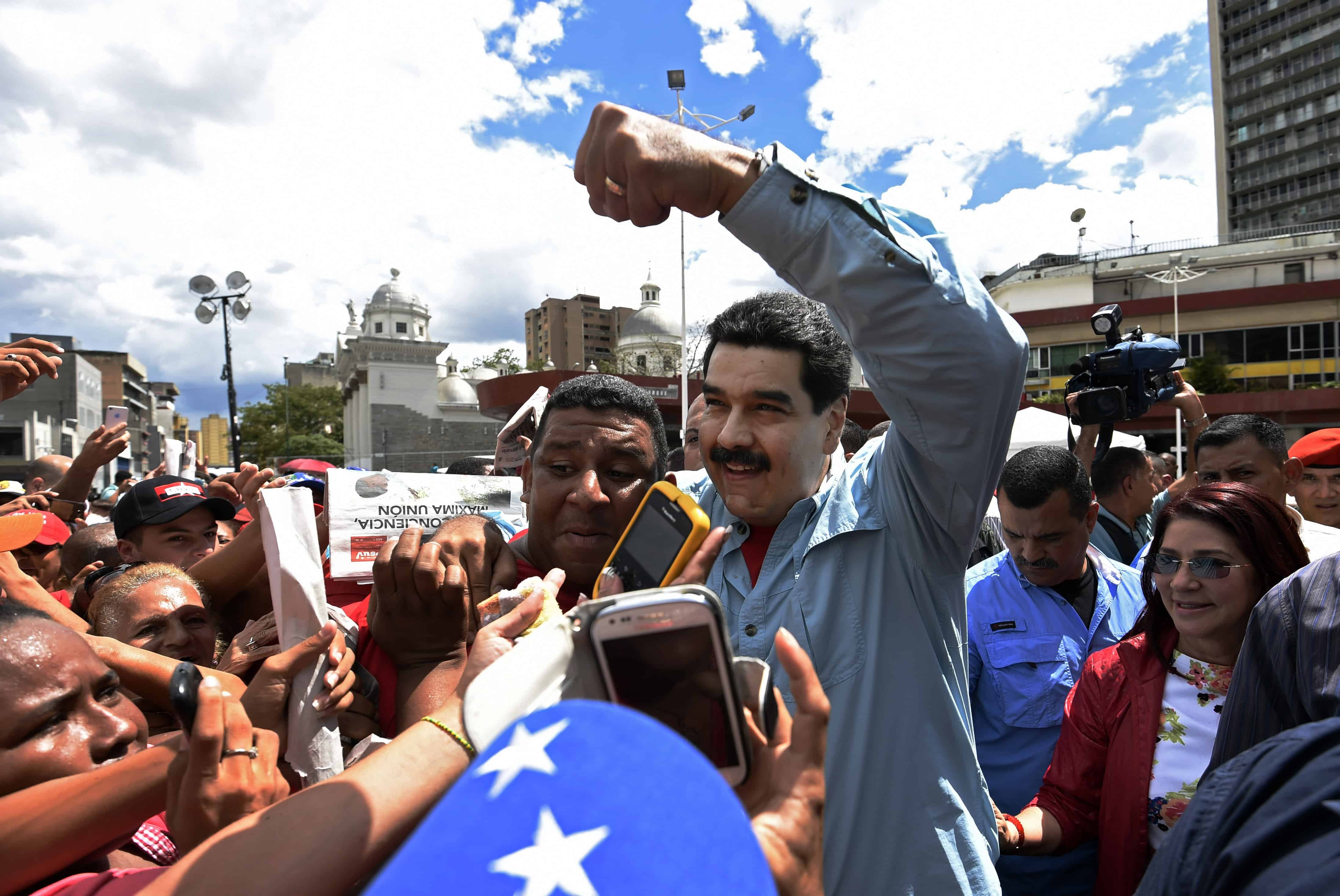 Venezuelan President Nicolás Maduro greets supporters at a rally in Caracas.