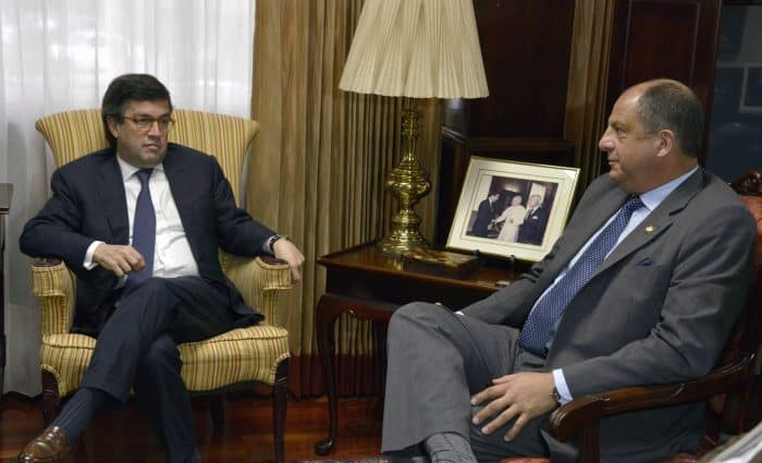 Costa Rican President Luis Guillermo Solís, right, meets with the president of the Inter-American Development Bank, Luis Alberto Moreno.
