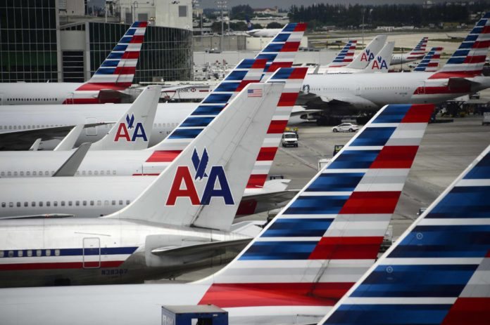 American Airlines planes stand on the tarmac at Miami International Airport.