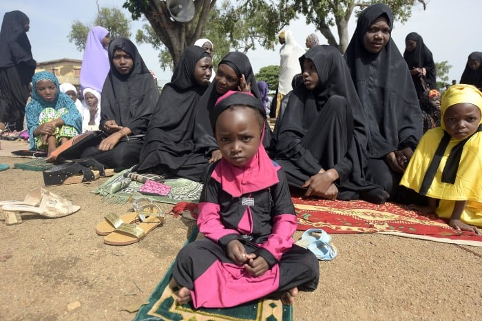 Muslim women and girls attend Eid al-Fitr prayers at the Isa Kazaure praying ground in Nigeria's central city of Jos.