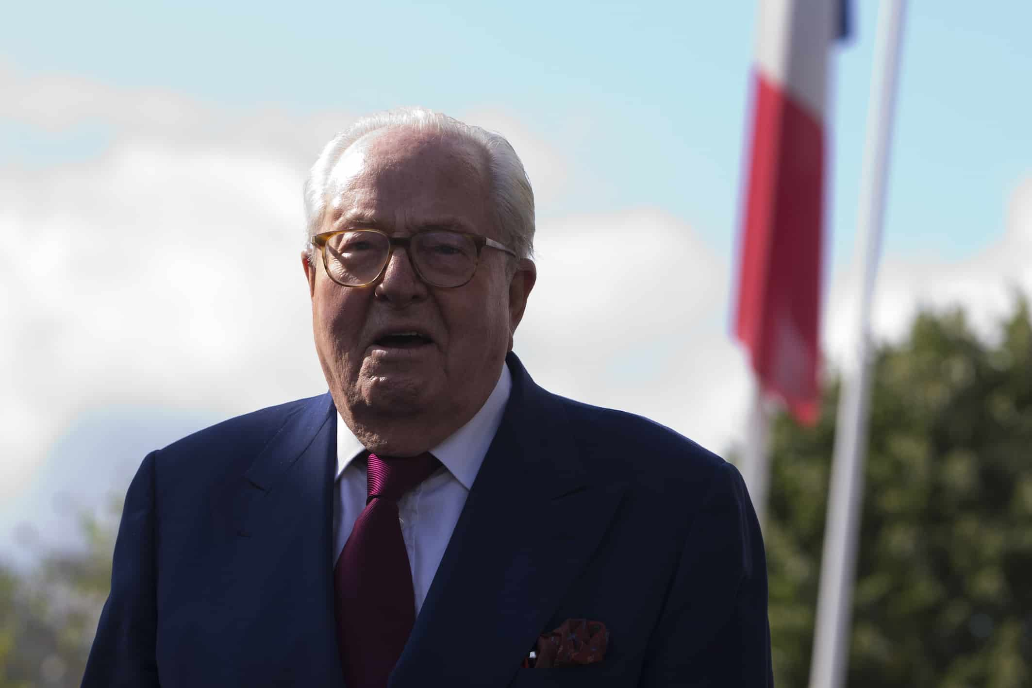 French far-right National Front (FN) party founder and honorary President Jean-Marie Le Pen leaves the party's headquarters in Nanterre, near Paris, on August 20, 2015.