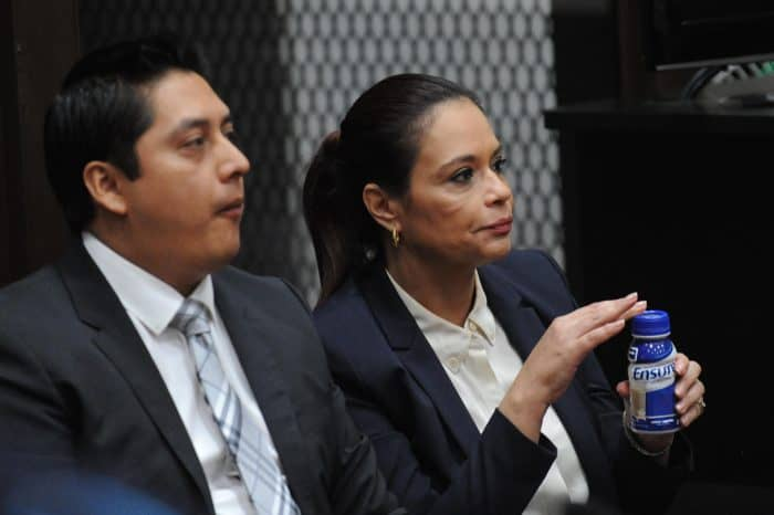 Guatemala's former Vice President Roxana Baldetti, right, sits next to her lawyer Mario Cano during a hearing in court.
