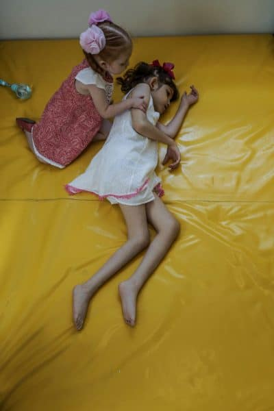 Valentina Elizalde, 2, left, with her sister Grace in the playroom of their house in Monterrey, Mexico, on August 12, 2015.