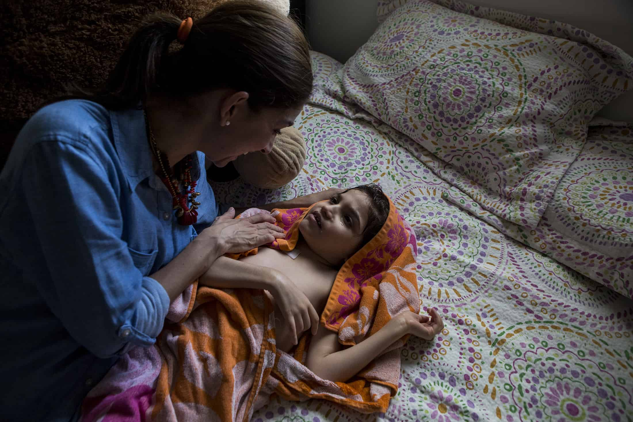 Mayela Benavides changes her daughter Grace after bathing her in their home in Monterrey, Mexico, on August 12, 2015.