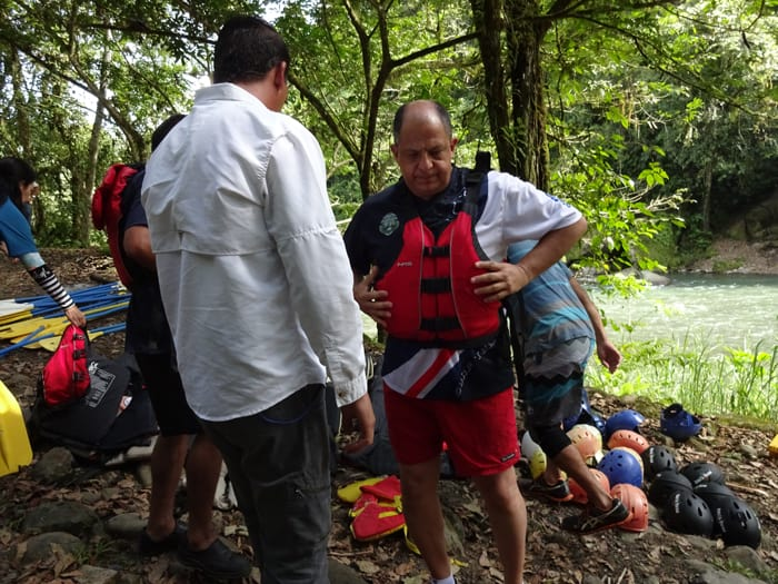 Solís adjusts his life vest in preparation for rafting.