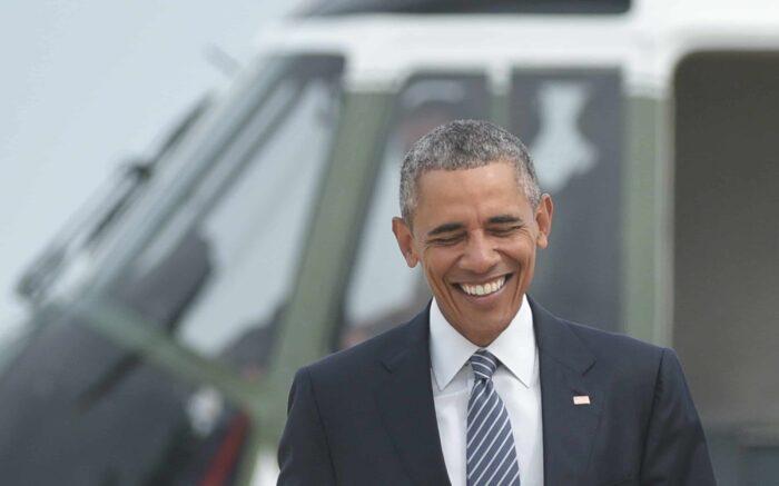 U.S. President Barack Obama walks across the tarmac to board Air Force One.