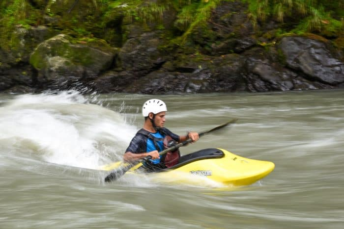 Kayakers often accompany rafting groups to help in case of trouble, but they spend much of their time honing their kayak rodeo skills.