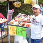 A vendor along the route sells natural juice and fruit during the 2015 Romeria August 1, 2015.