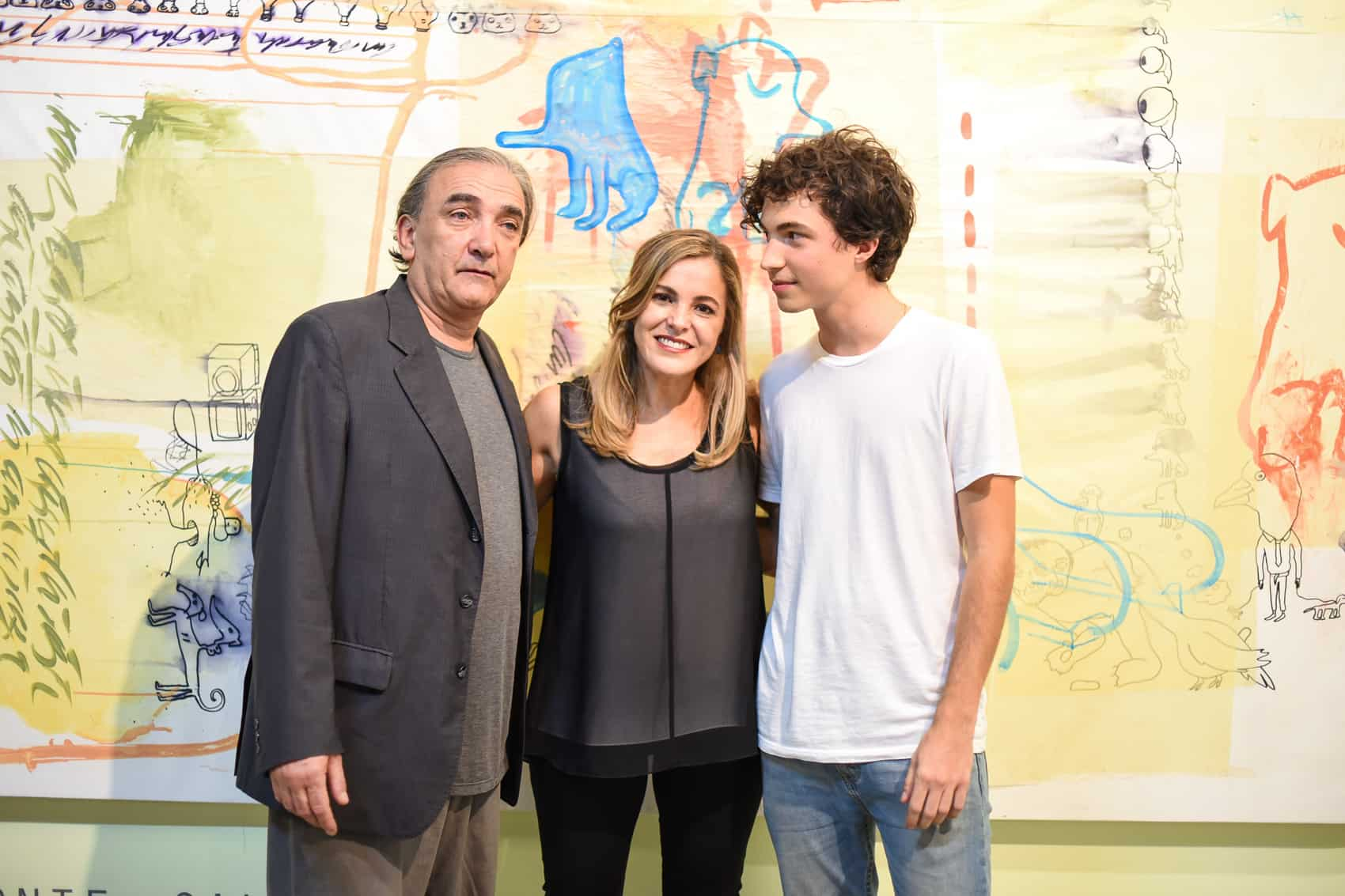 Consolidated artist Guillermo Conte (left) with Tandem's organizer Karen Clachar (center) and emerging artist Costa Rican artist Julián Gallese (right), in front of a piece made by Conte and Gallese.