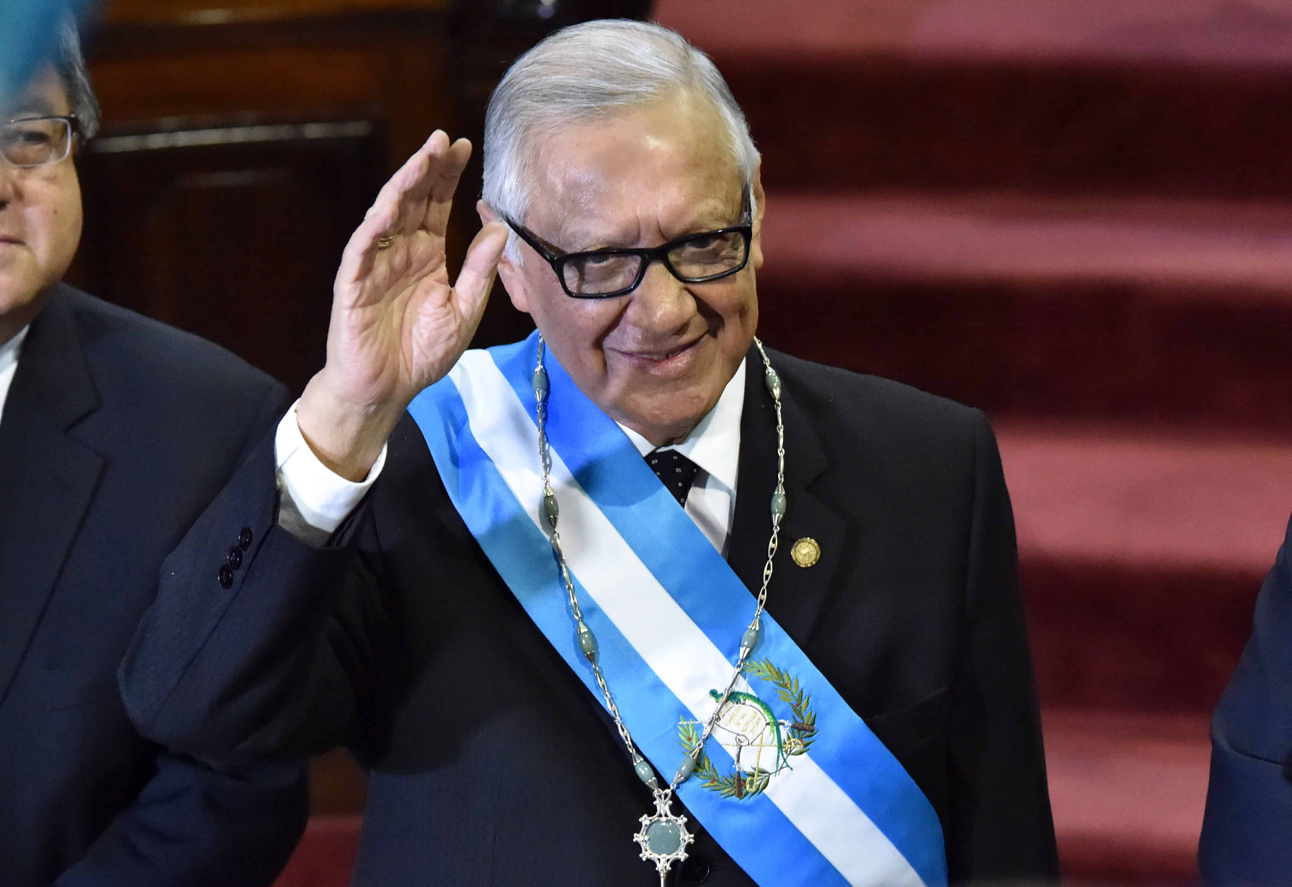 Guatemala's new President Alejandro Maldonado Aguirre waves after being sworn in.