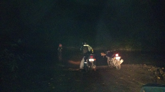 For illustrative purposes: A picture of the Bongo River crossing on the Nicoya Peninsula at night last month, taken by a Tico Times reporter who met two people on motorcycles there. One of them waded the river to find a shallow place to drive across.