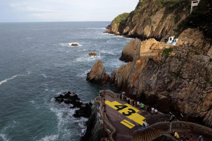 Greenpeace protests against the disappearance of 43 students from Ayotzinapa, at La Quebrada in Acapulco, Mexico, on Sept. 6, 2015.