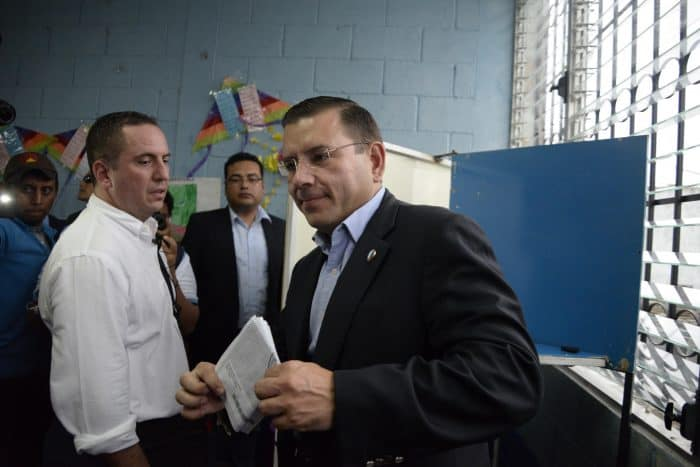 Guatemalan presidential candidate for the Renewed Democratic Liberty Party, Manuel Baldizón, right, votes in Petén, 580 km north of Guatemala City, on Sept. 6, 2015.