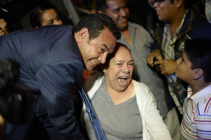 Presidential frontrunner Jimmy Morales celebrates with supporters after preliminary results for the general elections are released, at party headquarters in Guatemala City, early on Sept. 7, 2015
