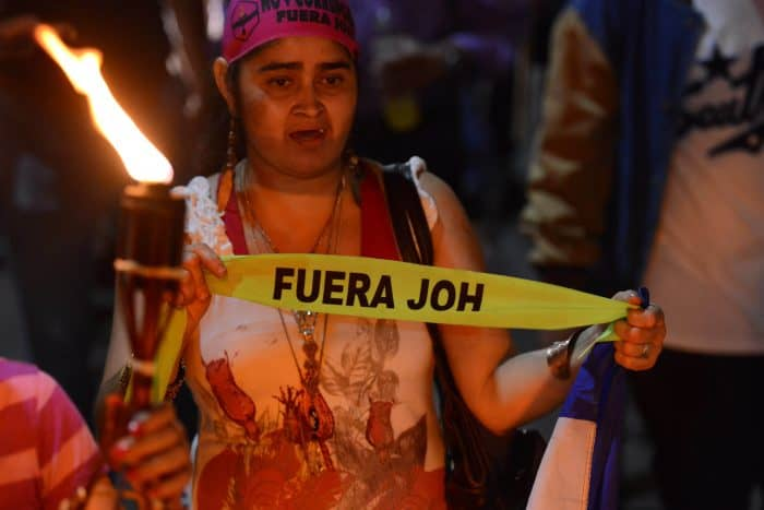 A protester calls for Honduran President Juan Orlando Hernández to step down.