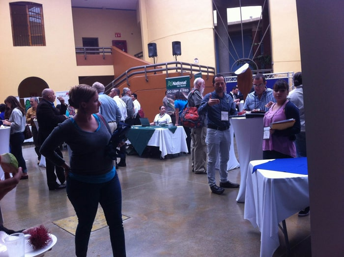 Exhibitors and attendees at the Planet, People, Peace conference on sustainable tourism Thursday in the Children's Museum in San José.