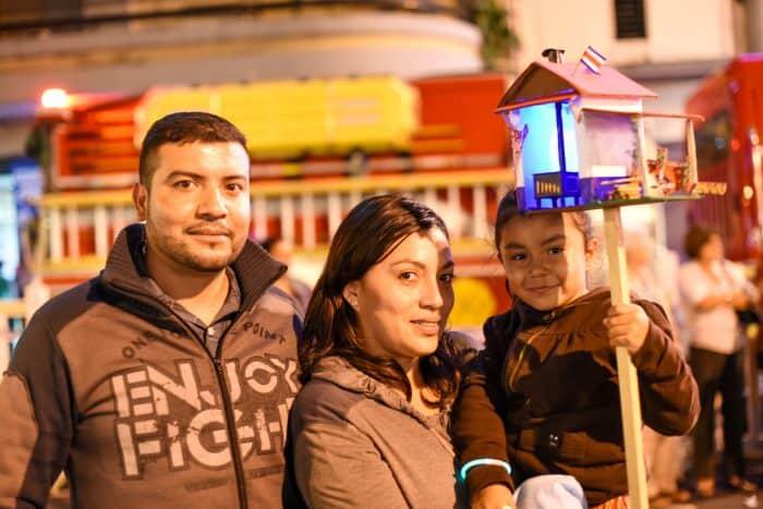 Families attend the Desfile de Faroles in San José marking Costa Rica independence.