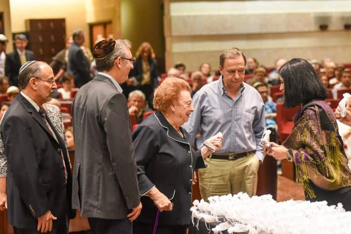 Magda de Davidovich, center, and other holocaust survivors and their families receive an honorary recognition at the Jewish Center's synagogue, Tuesday, September 01.