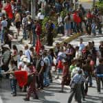 Indigenous Guatemalans march and block a street in Guatemala City on Aug. 27, 2015. That week, Pérez Molina suffered a double setback as the country's top prosecutor called for his resignation and his ex-vice president was sent to jail.