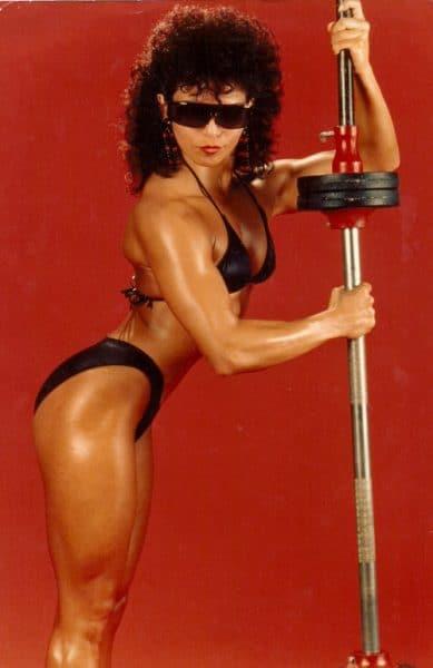 Monica in a bodybuilder pose.