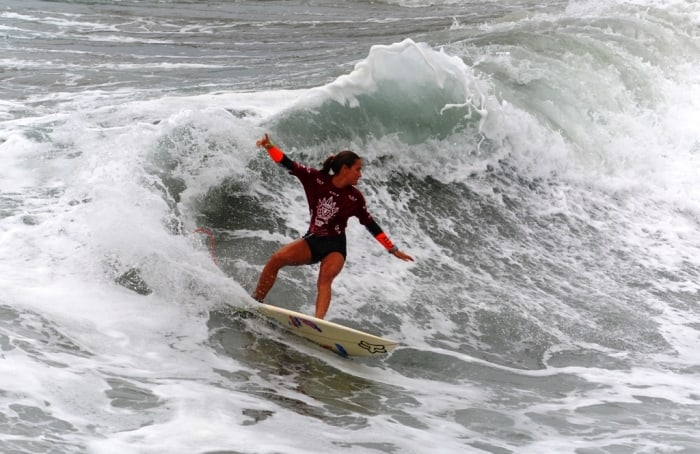 Emily Gussoni surfing