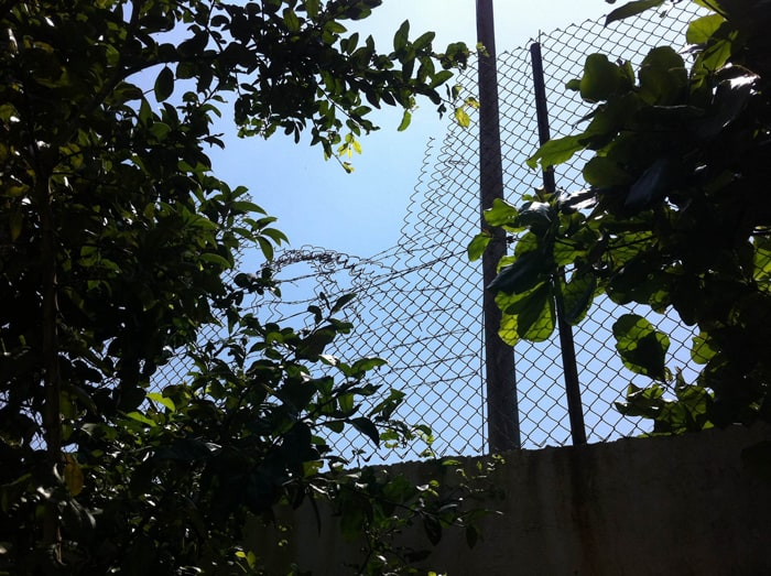Chain-link fence atop a wall in Esterillos Oeste.