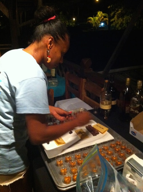 Shots of whiskey and chunks of chocolate are prepared for guests of the Puerto Viejo Chocolate Festival.