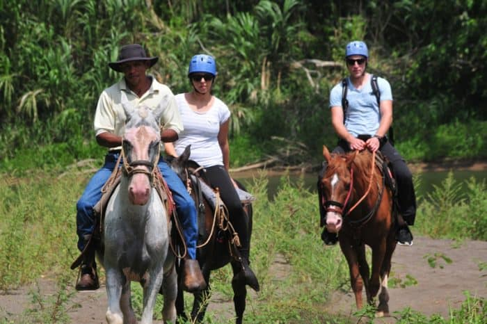 Tourists horseback riding