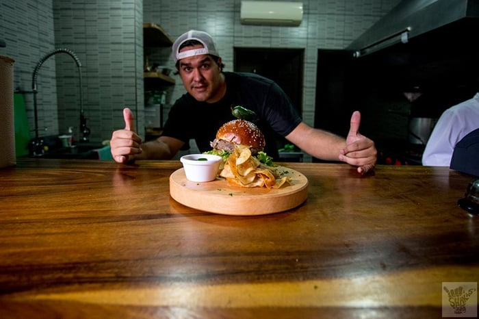 Fabricio Riggioni with one of his giant hamburgers.
