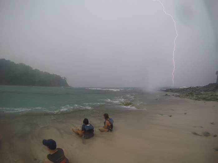 Lightning strikes the ocean off Sámara as stranded kayakers sit on Isla Chora.