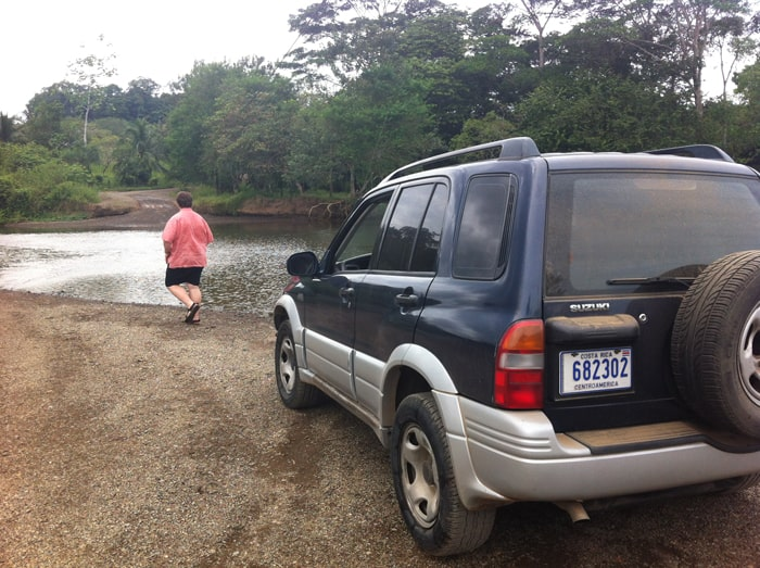 Jordan sets out to wade the Río Drake to find the best way across.