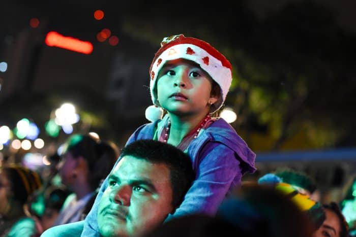 Emily Villalobos, 6, enjoys the lighting of the Christmas tree at the Children's Hospital on Thursday, December 3, 2015.