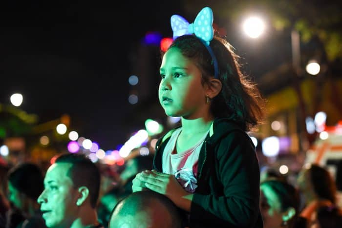 Naomi Salinas, 5, gazes at the newly lighted Christmas tree at the Children's Hospital in downtown San José.